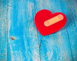 Heart bandage on wooden